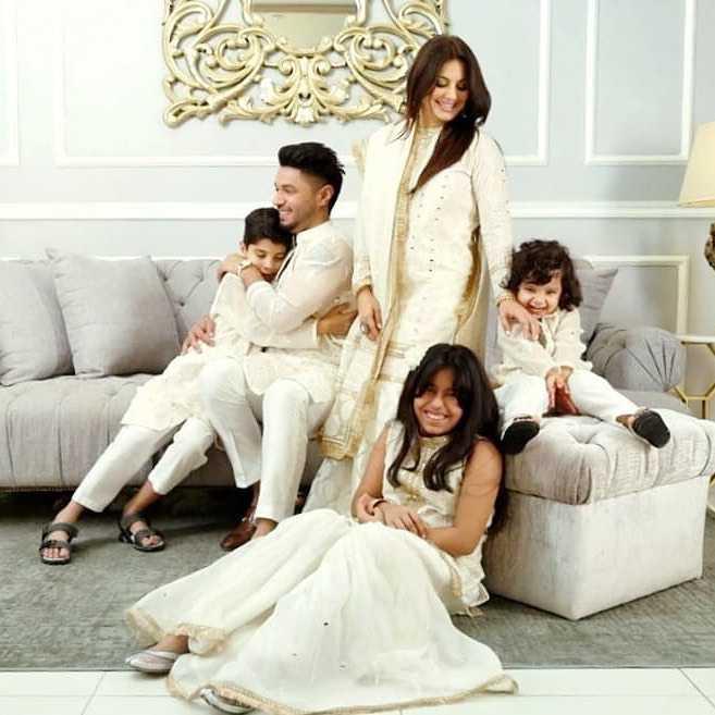 hasan rizvi with his wife and kids